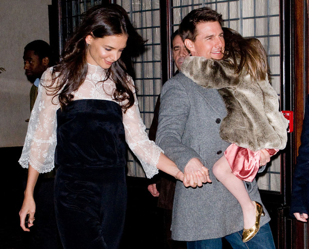 Katie Holmes and Tom Cruise leaving their Manhattan hotel with daughter Suri to celebrate Katie&#39;s 33rd birthday at the Buddakan Restaurant.