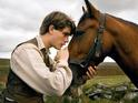 Steven Spielberg's War Horse gallops into first place at the UK box office.