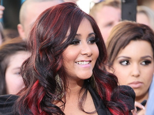 Nicole 'Snooki' Polizzi films an appearance on the entertainment news show 'Extra' at The Grove Los Angeles