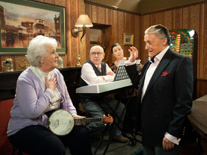 Sylvia is about to start her music contest with Norris when she is delighted to see Milton appear beside her