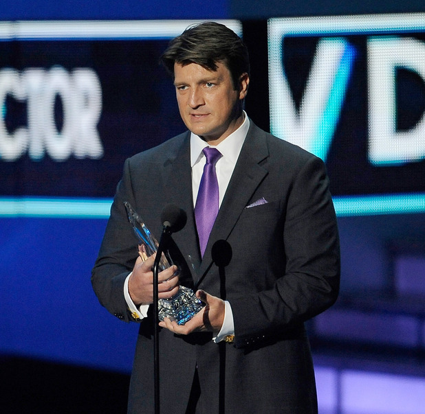 Nathan Fillion cradles his &#39;teardrop of joy&#39; for &#39;Favourite TV Drama Actor&#39;.
