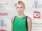 "Charlize Theron has been ""patient"" during the adoption of her young son."