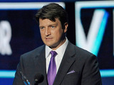 Nathan Fillion cradles his 'teardrop of joy' for 'Favourite TV Drama Actor'.
