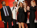 Judd Apatow and the cast of Bridesmaids burst into song on stage.