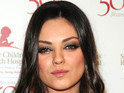 "Mila Kunis says that rumors she is dating Ashton Kutcher are ""absurd""."