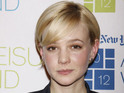 Carey Mulligan says that spending time in America doesn't feel like real life.