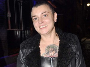 Sinead O'Connor is all smiles as she exits the stage door of The Olympia in Dublin Dublin, Ireland