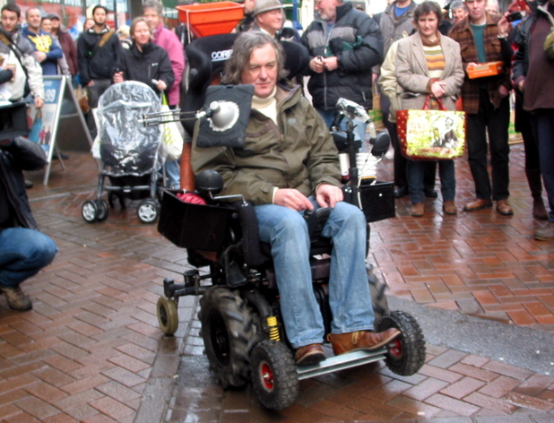 James May races his Top Gear co-presenters on a customized mobility scooter through Abergavenny Town,  as they film scenes for the new series of the hit BBC motoring show Abergavenny, South Wales - 18.01.12