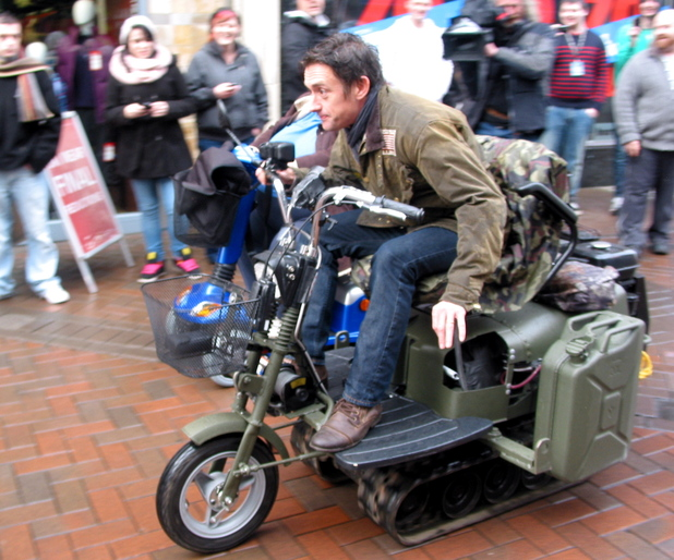 Richard Hammond races his Top Gear co-presenters on a customized mobility scooter through Abergavenny Town,  as they film scenes for the new series of the hit BBC motoring show Abergavenny, South Wales - 18.01.12