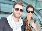 Brian McFadden and new fiancee Vogue Williams are seen arriving at Dublin Airport from Australia. Dublin, Ireland