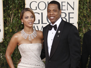 Beyonce, left, is joined by husband Jay-Z, as she arrives at the 66th Annual Golden Globe Awards on Sunday, Jan. 11, 2009, in Beverly Hills, Calif