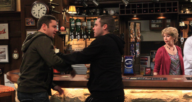 Tension rises as Aaron tells Adam that Chas and John's relationship is none of his business and refuses to get involved