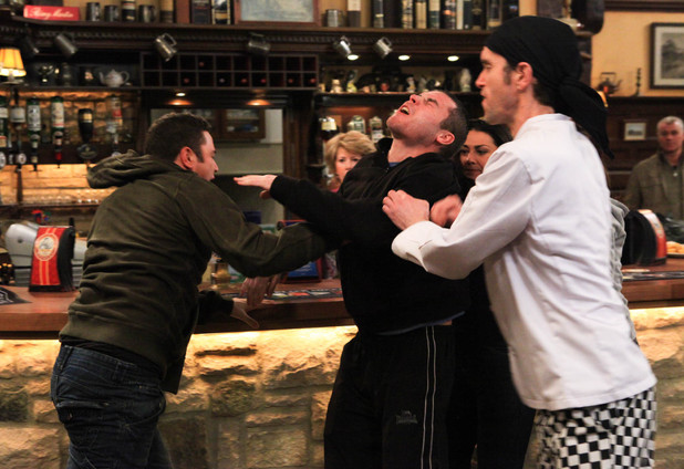 Marlon steps in to try and break up the brawl between Adam and Aaron