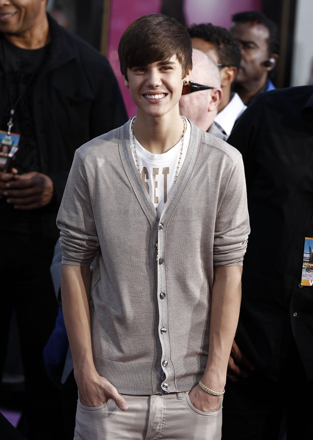 Justin Bieber poses for a photo during the hand and footprint ceremony honoring musician Michael Jackson