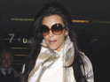 The intruder is alleged to have shown up at Kim Kardashian's home with luggage.