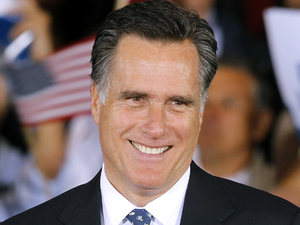 Republican presidential candidate Mitt Romney beams during his victory celebration after winning the Florida primary election