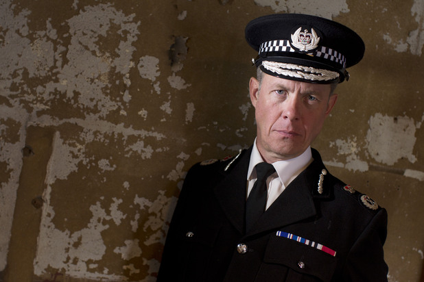 Griffin (Alex Jennings)