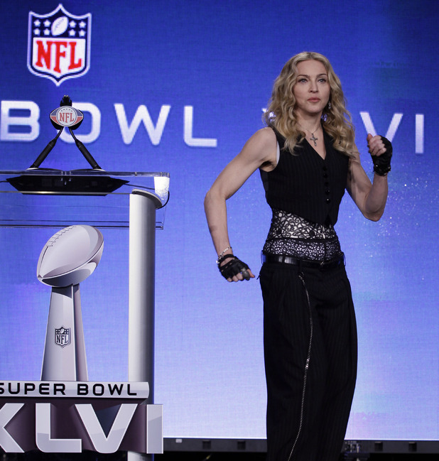 Madonna speaks during a news conference for NFL footbal's Super Bowl XLVI's halftime show
