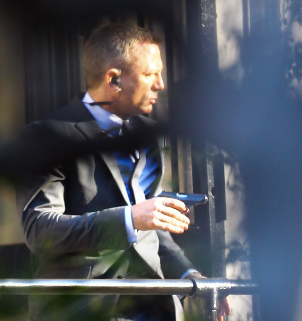 Daniel Craig clutches his Walther PPK