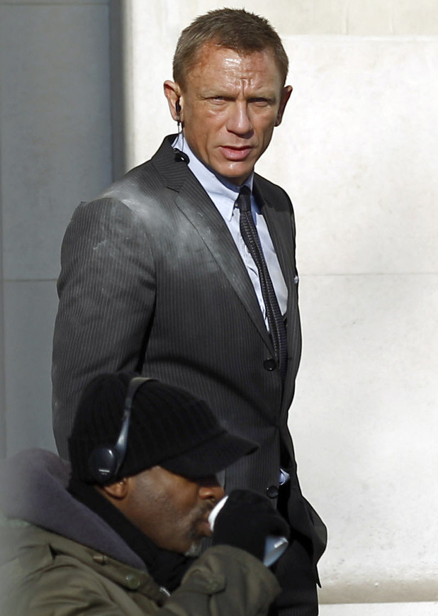 James Bond Skyfall set pictures: Daniel Craig with an earpiece.