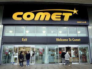 Shoppers outside a Comet store