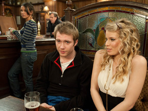 Tommy is overwhelmed by Jodie's enthusiastic flirting, whilst Tina watches and enjoys seeing him in discomfort