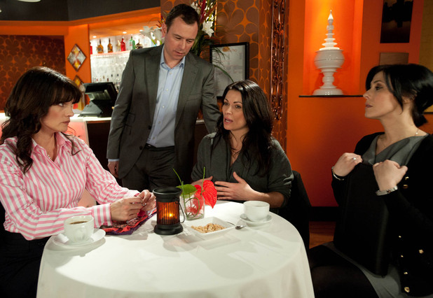Frank Foster (Andrew Lancel) interrupts one of Carla Connor's (Alison King) business meetings