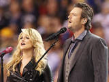 "Blake Shelton, right, and Miranda Lambert sing ""America the Beautiful"" before the NFL Super Bowl XLVI"