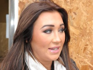 Lauren Goodger outside her beauty salon looking at the damage after her shop was petrol bombed
