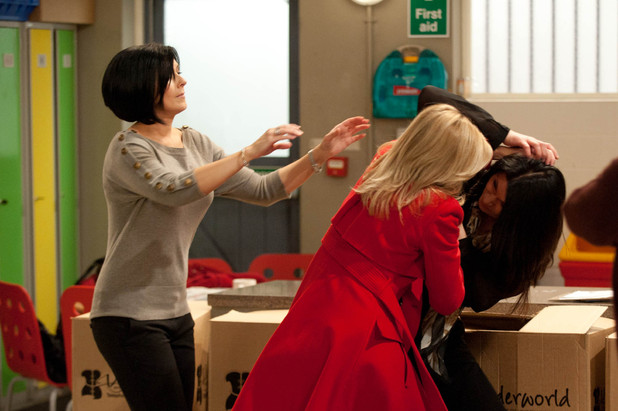 Everyone looks on as Leanne and Carla battle each other