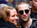 The Twilight star delights fans by stopping for pictures in Berlin.