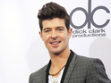 Robin Thicke jokes that Paula Patton sounds like Marilyn Monroe when she sings.