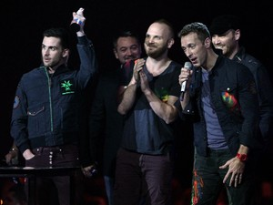 Coldplay collect the British Group award during the 2012 Brit awards at The O2 Arena, London