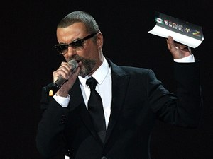 George Michael presents the MasterCard British Album of the Year award on stage during the 2012 Brit awards at The O2 Arena, London