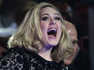 Adele collects the MasterCard British Album of the Year award on stage during the 2012 Brit awards at The O2 Arena, London