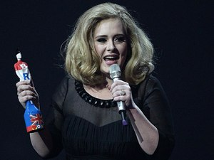 Adele collects the British Female Solo Artist award on stage during the 2012 Brit awards at The O2 Arena, London
