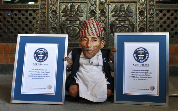 Nepal's Chandra Bahadur Dangi poses with his certificates after being declared the world's shortest living man and shortest man ever by the Guinness Book of Records.