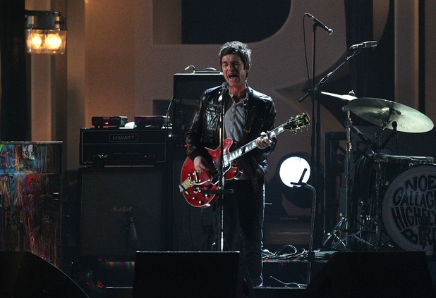 Noel Gallagher of Noel Gallagher&#39;s High Flying Birds performs on stage during the 2012 Brit awards at The O2 Arena, London