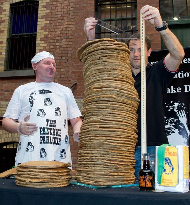 Andy Wrobel broke the Guinness World Record by building a 76-centimeter-tall stack of pancakes