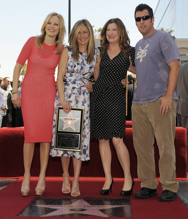 Jennifer Aniston poses with actors, from left, Malin Akerman, Kathryn Hahn and Adam Sandler after she received a star on the Hollywood Walk of Fame in Los Angeles
