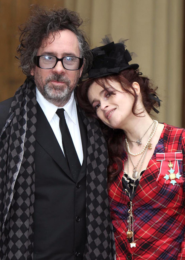Helena Bonham Carter and her husband Tim Burton pose with her Commander of the British Empire (CBE) medal, after an Investiture ceremony at Buckingham Palace