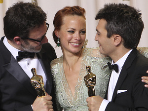 Michel Hazanavicius, Berenice Bejo and Thomas Langmann during the Oscars 2012