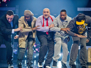 "Omid Djalili performs to Public Enemy ""Fight The Power""."