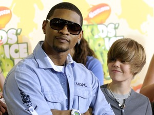 Usher, left, and Justin Bieber arrive at the 22nd Annual Kids' Choice Awards, March 2009