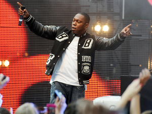 "Dizzee Rascal performing at the ""Coca- Cola London 2012 Olympic Torch Relay"" event at Westfield shopping centre London"