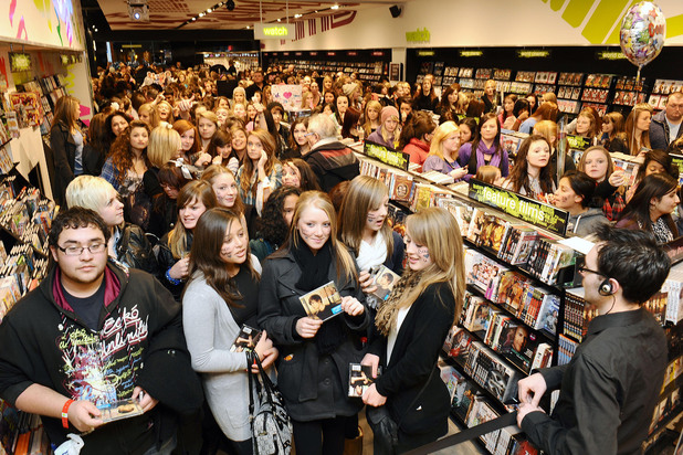 Fans wait to meet Justin Bieber at HMV in Westfield Shopping Centre, London. Jan 2010