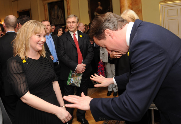 Prime Minister David Cameron bows to actress Joanna Page, who plays Stacey in the TV comedy show Gavin and Stacey