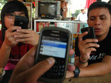 Blackberry users chat with their blackberry at Cafe Vendor In Jakarta, Indonesia