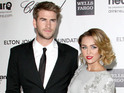 Singer and actress denies rumors of engagement to boyfriend Liam Hemsworth.