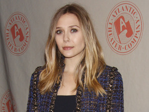 Elizabeth Olsen wearing a Chanel jacket and a 'The Row' dress (her sisters fashion label). The Atlantic Theater Company Spring Gala held at The Lighthouse at Chelsea Piers - Arrivals. New York City, USA
